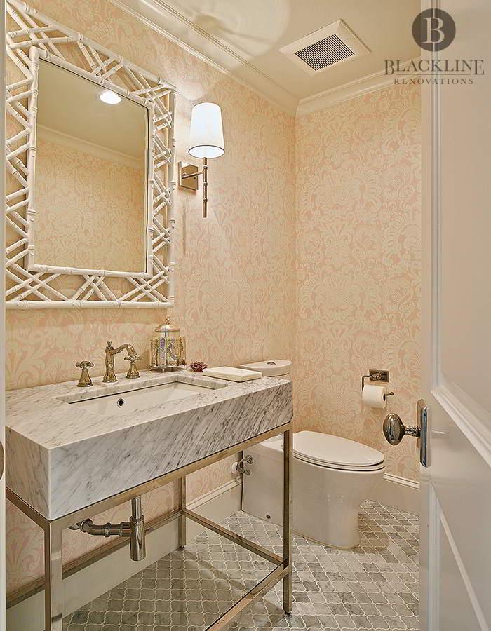 Pink Wallpaper, Carrara and metal vanity, framed mirror, wall sconces