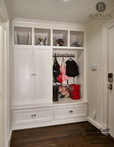Built-in lockers/cubbies, pained cabinets, wood flooring