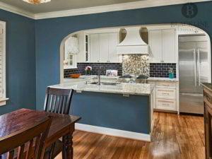 Painted cabinets, White cabinets, Granite Countertops, Peninsula, Subway tile backsplash, Custom vent hood, Jenn Air Appliances