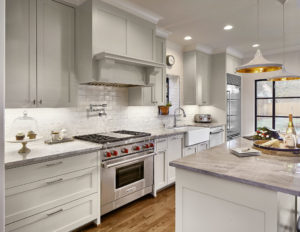 Kitchen with Custom Vent Hood and Pendant Lighting in Highland Park Dallas