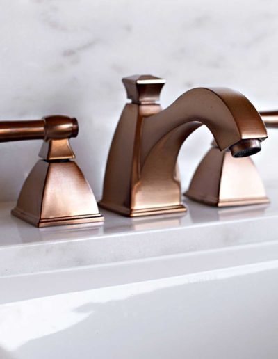 Beige-and-White-Light-Bathroom-with-Copper-Faucet-in-Bellbrook-Estates-Dallas