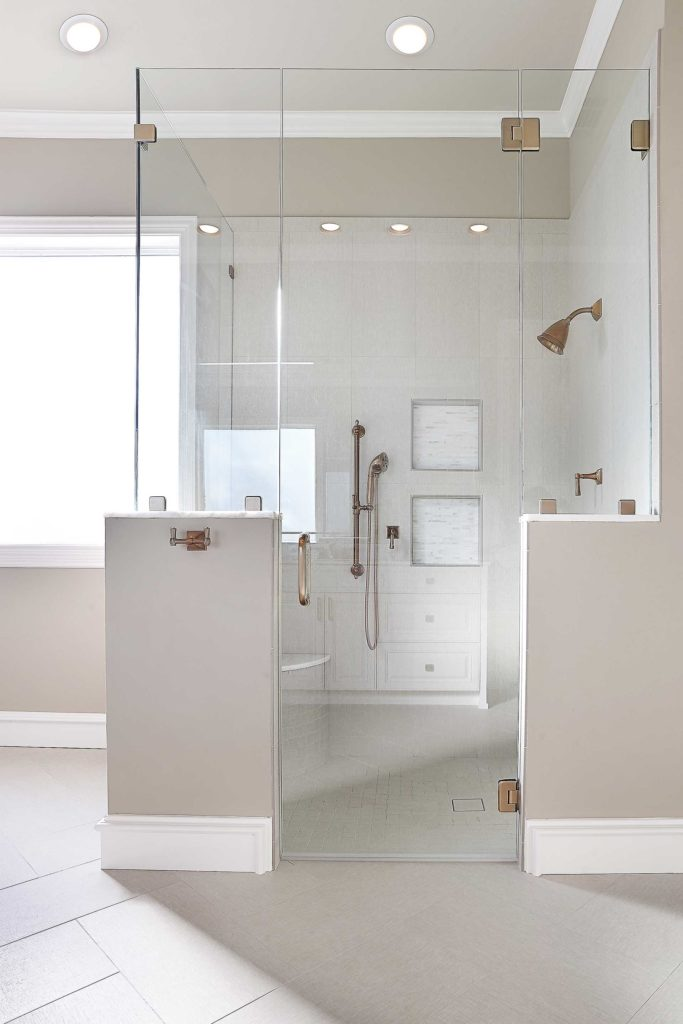 Beige-and-White-Light-Bathroom-with-Copper-Shower-Fixtures-in-Bellbrook-Estates-Dallas
