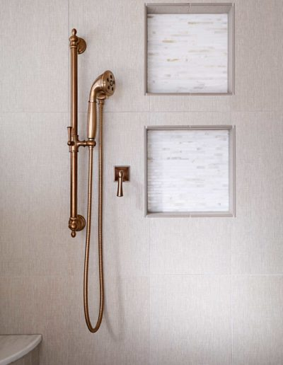 Beige-and-White-Light-Bathroom-with-Copper-Shower-Head-and-Custom-Shelves-in-Bellbrook-Estates-Dallas