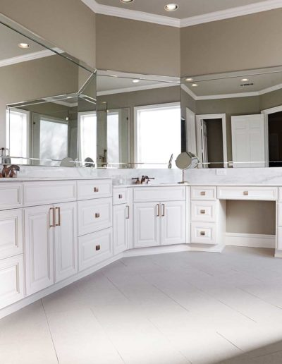 Beige-and-White-Light-Bathroom-with-Mirrors-and-Copper-Knobs-in-Bellbrook-Estates-Dallas