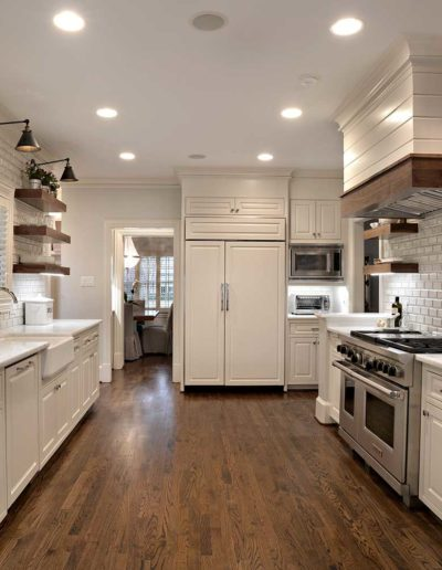 White Rustic Kitchen with Wood Flooring
